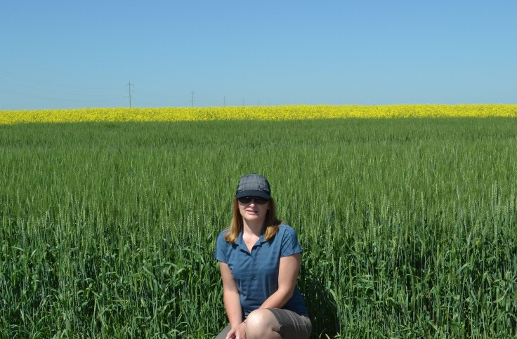 Posing in front of green wheat, yellow canola and a blue sky.