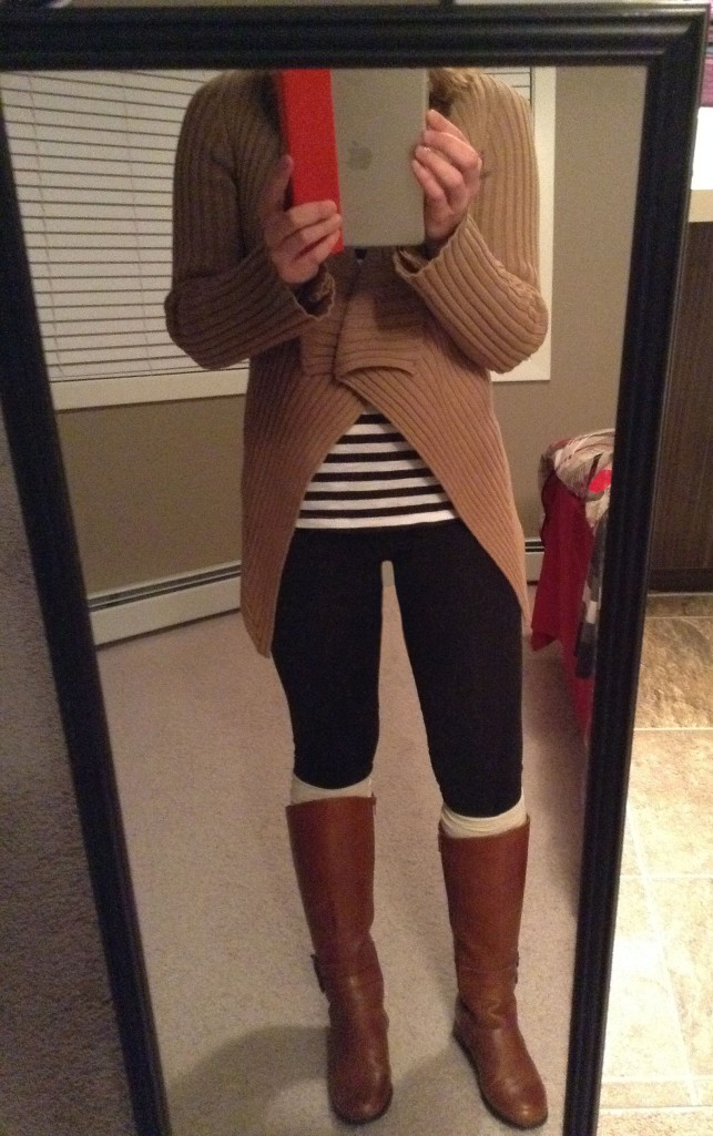 Leggings, brown sweater, striped shirt and riding boots.