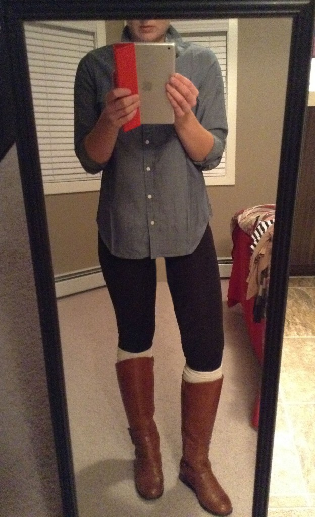 Leggings, denim shirt and riding boots.