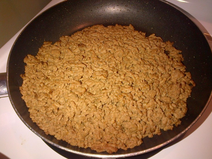 Brown ground beef.
