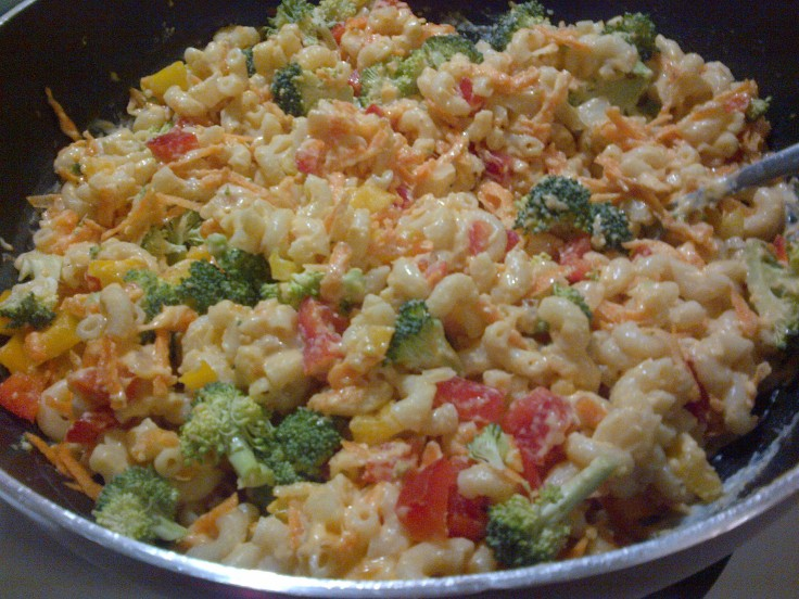 Add the macaroni and veggies to the cheese sauce.
