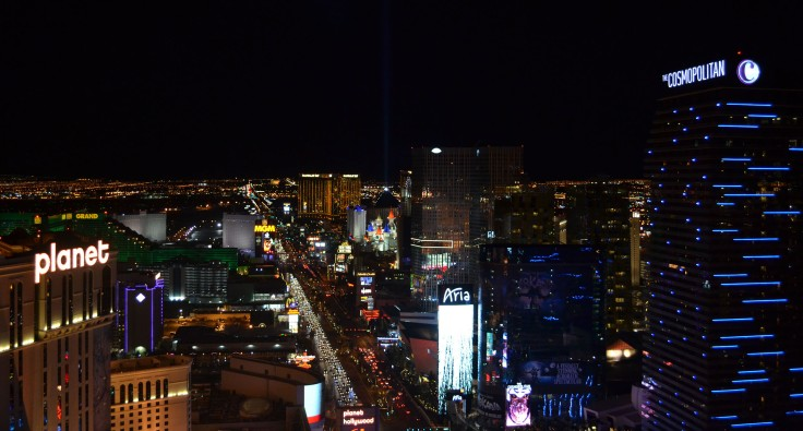 View of The Strip from the top of the Eiffel Tower at night.