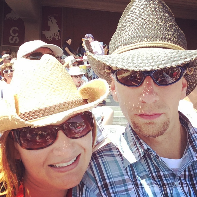 Taking in the rodeo on a hot afternoon.